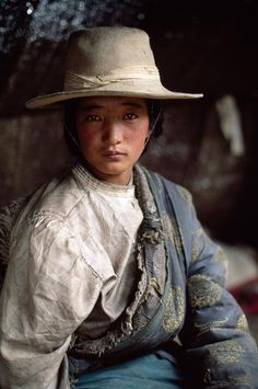 Asia | Portrait of a young Tibetan woman wearing traditional clothes and hat, Tibet | © Steve McCurry