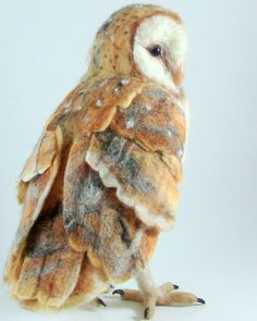 A needle-felted animal by Robin Joy Andreae, Stella the owl is both needle felted and wet felted. She has polymer-clay feet and beak, also tiny pearl seed beads on her white spots. #owl #needlefelting