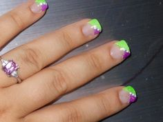 My neon green and purple acrylic nails !!  Follow me on YouTube ;)  http://www.youtube.com/user/amberv216/videos?flow=grid=0