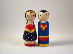 Wonder woman & Superman... These would make GREAT cake toppers... for a wedding!!! ;)