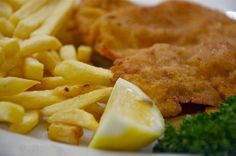 Wiener Schnitzel - most typical austrian food. Made traditionally with veal, but also offered with pork. Very thinly pounded and breaded meat - melts in your mouth. The Austrians offer it with a wedge of lemon and a condiment that reminds me of cranberry sauce.
