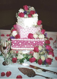 This creative cake is composed of a square bottom layer, a smaller square middle layer placed at an angle and a heart-shaped top layer. Baker - Brenda's Creative Cakery.