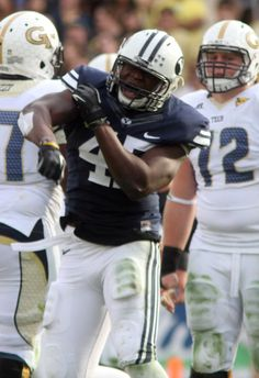 Brigham Young Cougars linebacker Tyler Beck (45) celebrates after sacking the Yellow jacket's quarterback, in football action BYU vs Georgia Tech, at Bobby Dodd Stadium in Atlanta, Saturday, October 27, 2012 (Rick Egan  | The Salt Lake Tribune)