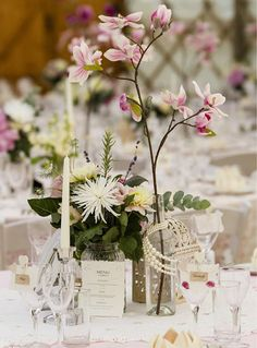 Real wedding styled by www.verdigrisvenuedressing.co.uk I vintage cut glass candle sticks and vases I pearls I pink and lace table cloths I wine bottles with magnolia stems