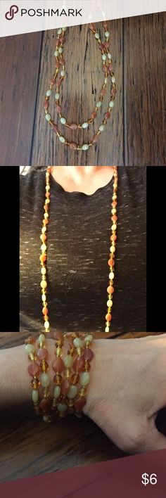 """Long Glass Beaded Necklace Warm Tones Versatile This 44"""" circumference necklace has been previously enjoyed and is now perfectly cleaned and polished and ready to wear.  It has no closure which makes it very versatile as a single or double necklace or even a multi strand bracelet.   Beautiful amber, cream and peach glass beads really catch the light. Feel free to bundle this with any other items in my closet for extra discounts. And as always I am happy to entertain any reasonable offers…"""