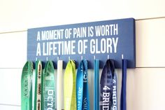 Medal Holder - A moment of pain is worth a lifetime of glory  - Medium - Running / Triathlon / Ironman / Obstacle / Tough Mudder / Spartan