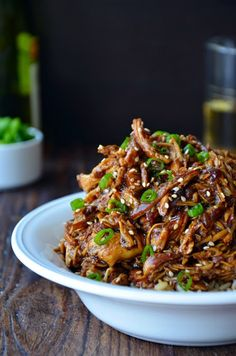 Slow Cooker Honey Garlic Chicken from Just a Taste; tender shredded chicken breasts tossed in a sweet and tangy sauce made with honey, garlic and soy sauce. [Featured on SlowCookerFromScratch.com] #SlowCooker #CrockPot #ChickenDinner