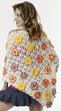 Crochet Floral Shawl. The background pattern stitch is really interesting even without the flowers.
