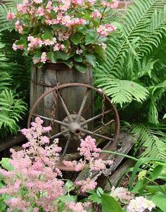 The Basket Bike Girl... pink flowers and old wagon wheel, old wood