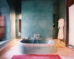 Moroccan Bathroom Photo - An oval bathtub in a blue-green bathroom