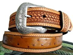 Come home to the new old west! This men's Nocona belt from M&F Western features a rich full grain leather construction; exquisite smooth ostrich leather; silver concho laced arrow overlay design with