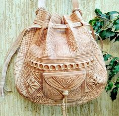 """*********MOROCCAN LEATHER BAG ********* This piece of art is made from beautifully-soft leather. It is hand embroidered with exquisite detailing on the top. *Best Quality leather *100% Handmade *Perfect for school or work *** Approximative dimensions*** Width: 36 cm / 14 """""""