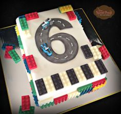 Lego cake. Lego Race Cars Cake. More at www.OneSweetTreat.com
