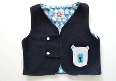 gilet in lana foderato con applicazione handmade