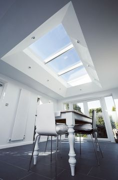 Daylight now floods this stylish dining extension with the addition of VELUX roof windows. Image supplied by Hilton Barnfield Architect, Exeter.