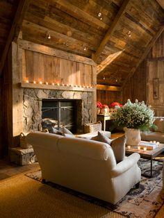 Stone, wood + candlelight mantled fireplace.