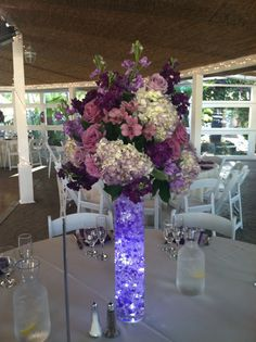 Purple centerpiece with hydrangea, stock, alstromeria, and roses. Lit up with submersible lights and purple bead gel.