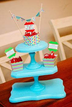 DIY Cupcake Stand using painted wood plaques and candle holders. Glue together with E6000.