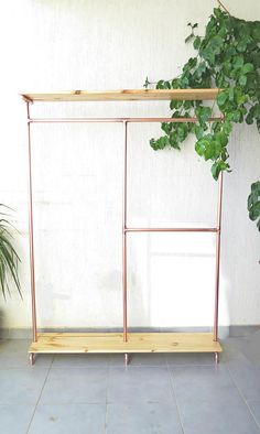 Copper two sided clothes stand = upper lower wooden shelf (O = wheels) # Clothing Store Design, Clothes Stand, Shelf Furniture, Garment Racks, Aesthetic Bedroom, Wooden Shelves, Diy Garden Decor, New Room, Home Decor Accessories