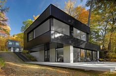 lake house, Black House Paint Exterior Design With Wooden And Concrete Material: Cool and small minimalist modern cube house design in the l. Modern Exterior, Exterior Design, Black Exterior, Residential Architecture, Interior Architecture, Style At Home, Haus Am See, Metal Siding, Metal Cladding