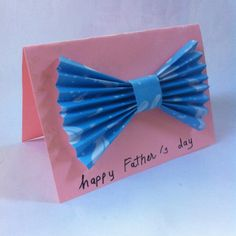 Easy bowtie card for Father's Day. The kids can easily make them with wrapping paper, scrapbooking paper, or construction paper.     Materials   	craft paper 	scissors 	glue