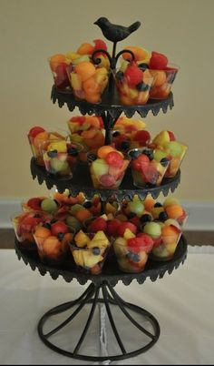Fruit cups.  Just buy small plastic glasses and fill them up.  Place on darling bird stand.  Love this idea