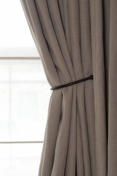 simple iron 'tiebacks' on taupe linen curtains - Bieke Vanhoutte