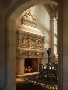 Regal cast stone Fireplace mantel in a palatial dining room - mantel is the 'Devon' from Tartaruga Design...