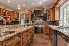 Wildwood, MO - This gourmet kitchen is complete with high-end stainless steel appliances including Thermador and Sub-Zero.