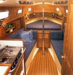 A table slides out form under the V berth and folds out around the mast step. Very clever!