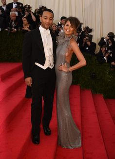 John Legend and wife Chrissy Teigen still have a newlywed glow at the Costume Institute of the Metropolitan Museum of Art's Charles James: Beyond Fashion exhibit on May 5 in New York