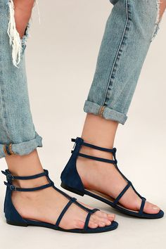"""Get ready to conquer the world in the Jayne Navy Suede Gladiator Sandals! Soft vegan suede straps cross over a peep toe upper, and meet adjustable buckle straps at the outstep. 4"""" heel zipper."""