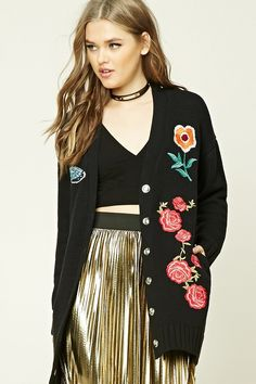 A midweight knit cardigan featuring a boyfriend silhouette, snap-buttoned front, embroidered florals and butterfly graphics, dual on-seam pockets, and long sleeves.