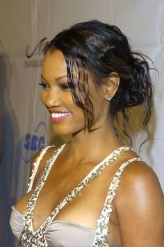 Buns for Every Face Shape: Sexy, face-framing layers help soften the angles of Garcelle Beauvais' square-shaped face.