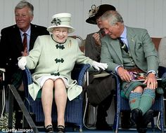 I love to see her laugh.  Queen Elizabeth gets the giggles with son Charles during the Highland Games.
