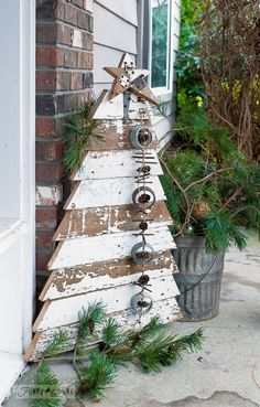 Reclaimed wood Christmas tree and star in chippy white boards for a front porch / http://funkyjunkinteriors.net
