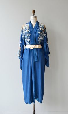 Antique 1920s silk and tissue silk lined floral kimono wrapper in cobalt blue with  floral print and long sash belt. ✂-----Measurements  fits like: fits most bust: free waist: free length: 52 brand/maker: n/a condition: this robe is lined and there are some tears in the lining (only), there is also some discoloration on the front, please see close up photos. ✩ layaway is available for this item  to ensure a good fit, please read the sizing guide: http://www.etsy.com/s...