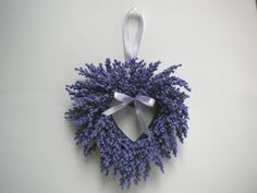 Lavender Heather Heart Wreath by SBF Gifts. $21.95. Size:  9.5 x 9.5 inches. Polyfoam with Satin Ribbon. Imported. Lavender Heather Heart Wreath. This is a mini-wreath of faux lavender heather on a styrofoam backing with matching satin bow and hanger.  Use as a wall decor grouping with family photos, mirrors, prints, etc. Makes a nice gift at a bridal or baby shower.  Hang on the wall above a baby's crib or bed.  Let your imagination run wild!