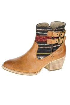 """Durable and loaded with personality, these vibrant boots have a creative mix of buckles, leather and canvas. Tribal influenced patterns for a look that's perfect for summer festivals. We recommend ordering a halfsize down.    Heel: 2""""   Willa Canvas Boot by Cat Footwear. Shoes - Booties - Heeled Wisconsin"""