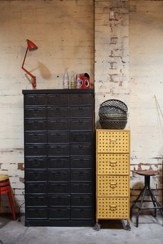 Love this yellow file cabinet.The red lamp...groovy.The stool,nice.