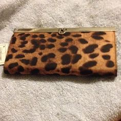 ⬇️final reduction. New leopard wallet Very beautiful wallet. Checkbook holder. Money slots. Holds at least 8 cards. Zippered change area. Bags Wallets