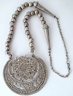 by Ann Porteus 5779a Hilal al Shawwål necklace Shibam Yemen.  I collected this necklace in Shibam, Wadi Hadramawt in Yemen in 1997. The pendant was described to me as Hilal al Shawwål or sun and crescent moon.... Creative Commons: Some rights reserved