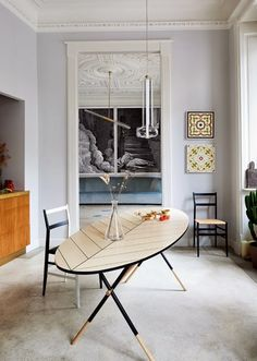 The 1920s Milan apartment of fashion photographer Adriano Russo, his wife Silvia and their baby girl is an intriguing...