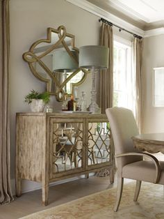 Mirrored pieces like this Sanctuary console give needed dose of sparkle