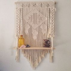 This Bella Macrame Shelf is a gorgeous way to display items.  Made from natural cotton rope, a pine rod and pine shelf.  This wall hanging shelf is 60cm (23.5) wide and 99cm (39) long from rod to end of tassels and 115cm (45) with hanging loop. The depth of the shelf is 14cm (5.5).  Each piece is made to order so please allow UP to 3 weeks for shipment.  As each piece is hand made there may be slight variations.  We have a range of coloured beads available so feel free to contact us for any…