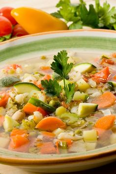 Healthy Tuscan Vegetable Soup with canellini beans, carrots, celery, zucchini, and spinach. Done in 35 minutes! Tuscan Vegetable Soup Recipe, Veggie Soup, Vegetable Soups, Zucchini Soup, Vegetable Recipes, Clean Eating, Healthy Eating, Vegetarian Recipes, Cooking Recipes