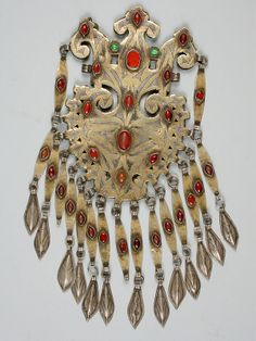 Silver gilded dress ornaments with cornelian from Central Asia.
