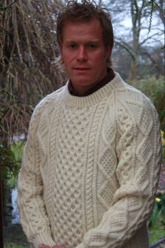 Irish hand knit sweaters ~ I would love to have an Irish knit sweater! Mens Knit Sweater, Hand Knitted Sweaters, Aran Sweaters, Sweater Knitting Patterns, Hand Knitting, Irish Clothing, Lana, Jumpers, Knitwear