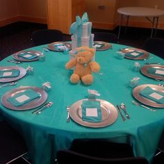 Table with stack boxes and teddy bear centerpiece