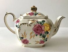 Stunning vintage teapot made by Sadler in England. The teapot stands 6 tall with pink roses and lots of gold details. It is in Good vintage condition, no chips, cracks, or repairs and the gilding is 99%. There is some crazing please see pictures. Please Note: The items I sell